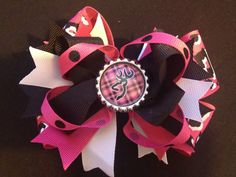 Stacked Boutique Style Hair Bow Pink, Black, & White with browning  symbol in center. $8.00, via Etsy.
