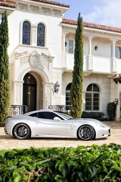 Forget the Ferrari - That is so the house for me...... JH Ferrari parked outside Style Estate