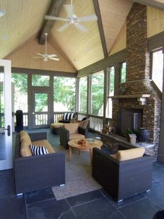 Outdoor Living Space : Screen Porch with stack stone fireplace.