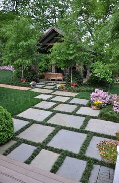 Garden Ideas. Stone Paver Garden Ideas. The grass between the pavers is Dwarf Mondo Grass. Ophiopogon japonicus 'Nana'. #Garden #GardenIdeas #Pavers   The Collins Group.