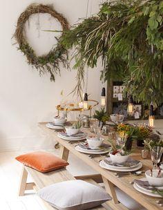 Festive greenery table setting.