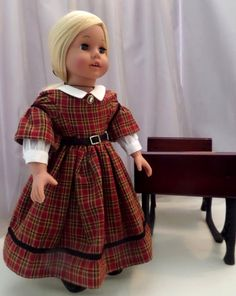 Victorian Doll Dress / Black Petticoat / 18 Inch Doll Clothes / Doll Clothes / Doll Clothing Doll Accessories / Fits American Girl Doll - 1035 The elaborate design and the plaid homespun cotton fabric used for this dress fulfills the distinctive fashions worn in the mid 19th