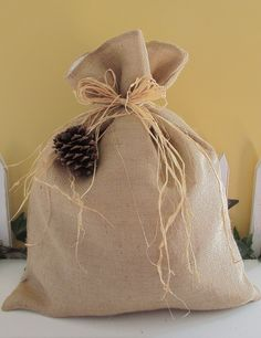 Burlap gift bag, XL size from GigiBags on Etsy. Of course I've used this!