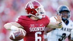 Baker Mayfield tossed three touchdowns and threw for 388 yards as the Sooners rolled past Akron, 41-3, to begin the 2015 season.