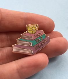 Hey, I found this really awesome Etsy listing at https://www.etsy.com/listing/471207811/drink-tea-read-books-enamel-pin