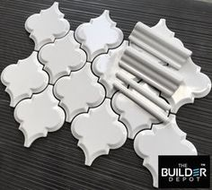 Beveled Whisper White Arabesque Tile. Just $10.95 a Square Foot. This Tile with matching trims is ideal for a quick backsplash improvement or any bathroom wall feature. #arabesque