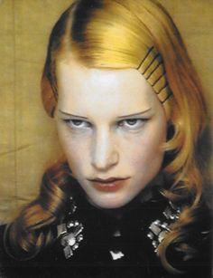 True butterscotch-collored hair. Bobby pins, strong side part, curl the ends. Kirsten Owen in Yohji Yamamoto, photographed by Paolo Roversi.