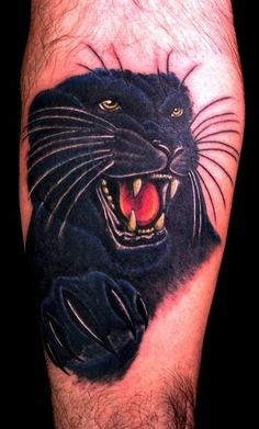 Portrait of a panther tattoo on leg