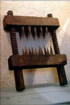 A popular torture device during the Inquisition, the knee splitter does what it says: split victims' knees and render them useless. Built from two spiked wood blocks, the knee splitter is placed on top of and behind the knee of its victims. Two large screws connecting the blocks are then turned, causing the two blocks to close towards each other and effectively destroy a victim's knee.