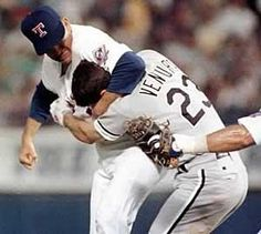 August 4, 1993: Robin Ventura charged the mound to fight Nolan Ryan, but Ventura ended up in a headlocked and pummeled six times by Ryan. Go Texas Rangers!!!