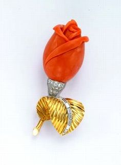 CARTIER, PARIS VINTAGE CARVED CORAL, GOLD AND DIAMOND BROOCH  c 1950