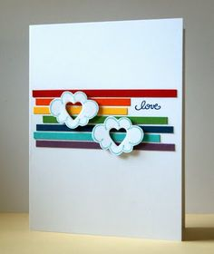 """cut strips of paper in rainbow colors & place on card base; stamped DeNami clouds & cut out; die cut hearts in the middle of each & adhere them over color strips; """"love"""" sentiment, from DeNami."""