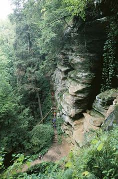 Outdoors enthusiasts come here to explore wooded trails, caves and rock formations. Ash Cave at Hocking Hills, OH