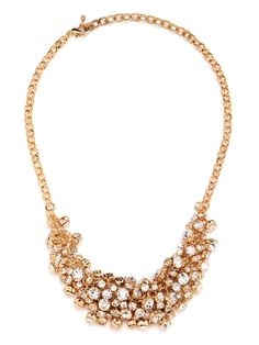 Strength in numbers? You bet. This stunning statement necklace—crafted from a gorgeous cluster of dangling crystals—proves that more is oh-so-glamorously more.