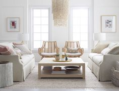 A laid-back living room with subtle pops of pink   Image via Serena & Lily