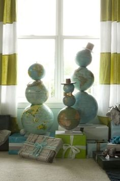MAKE   How-To: Globe Snowman Family by Emily Henderson
