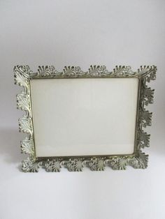 This is a large silver tone metal frame with a dramatic ivory/white washed ornate leaf and floral design. It has an easel back for tabletop to use either vertically or horizontally. It has two metal rings on the back to hang it vertically or horizontally. The backing is burgundy velveteen. Please Vintage Picture Frames, Vintage Pictures, Frame Gallery, 10 Frame, Ivory White, Vases Decor, White Paints, Easel, Tabletop