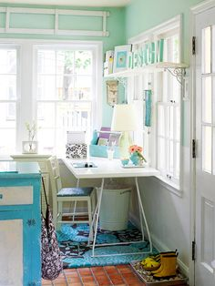 Blue walls and white furniture in a sunny mudroom
