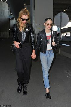 Smitten: Kristen Stewart and Stella Maxwell went hand-in-hand as they touched down togethe...
