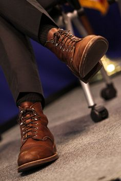 redwingshoestoreamsterdam:  A pair of 8111 Iron Rangers beneath suit trousers
