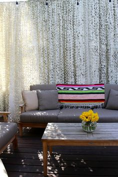 Carrie & Hal's Modern Bohemian Home  Cammo netting privacy screen a wonderful idea for outdoors.  Back fence?