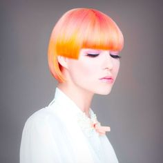 Beautiful ombre that slips from melon pink to yellow and orange. Color: Jennifer Roskey Photog: Babak #HotOnBeauty #ShortHair #Ombre #YellowOrangeHair