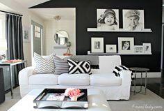 Dark accent wall with shelves and frames