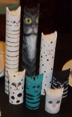 Saw these on Pinterest and just had to make them for a cat themed birthday party. They are from t.paper tubes! They were so fun to make. They aren't exactly like the originals which are here in my Pins Ive Tried Board, but we loved them! We pinched the tops to form the ears first. Then we painted the tubes with acrylic paint and let dry. Then we added details.Try some! They are addictive. Everyone loved them and they were the hit of the party! They look adorable on the  bookshelf.
