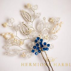 """We love creating bespoke pieces for future brides but we also adore making beautiful pieces for maid of honours and bridesmaids. Here is a recent bespoke creation for a maid of honour. A Navy Blue Novia Hairpin. Such a """"something blue"""" beauty! Lovely close up photography by #TimParkePhotography #hermioneharbutt #bespoke #unique #designs #couture #accessories #Navy #Blue #handmade #hairpin #pearls #realpearls #freshwaterpearls #Swarovski #crystals #heavenly #statement #hairpieces #wedding…"""