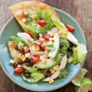 Chicken Tostada Salad - This is a refreshed version of the ubiquitous taco salad, with lean chicken and chopped vegetables piled high on a crispy tortilla. For a shortcut, omit frying the tortillas and serve the chicken salad over large handfuls of good-quality corn tortilla chips.