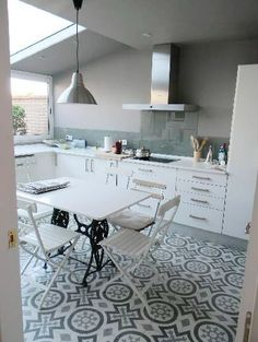 I really like this cafe table and chairs used in this kitchen.