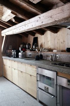 Love the way the exposed wood beams transform the kitchen into a warm, inviting space.