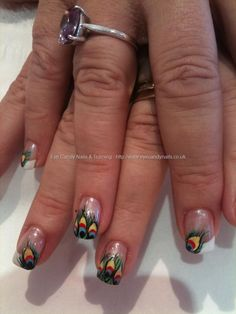 Peacock nail art, you will see some crazy designs if u click on this!