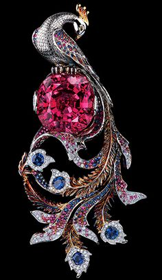 The Whimsical Queen of Phoenix -- Fairy Tales High Jeweller Pendant by Jewellery Theatre 18K white gold 204 diamonds 0,68-0,70 ct  245 blue sapphires 2,78-2,80 ct  256 pink sapphires 1,38-1,40 ct  1 tourmaline 40,97-41,00 ct