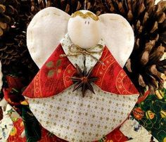 fabric angel...(no instructions at the link) make circle out of light Christmas fabric and darker Christmas fabric, turn right sides out, fold over collar, add a heart shape for the wings and a big flat round shape (covered button maybe or felt or flannel) for the head - gold rickrack for the halo, a bow at the neck and something in the angel's hands