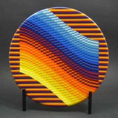 Platter made out of hundreds of pieces of colored glass fused together
