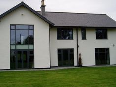 grey slate with white render and modern alu windows.note the openable parts of the windows are high and therefore out of viewing line. Black Windows Exterior, Aluminium Windows And Doors, Grey Exterior, Cottage Exterior, House With Grey Windows, House Windows, House Exterior Color Schemes, House Paint Exterior, Exterior Colors