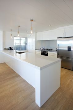 Kitchen area of this all white Lockwood beach bach.