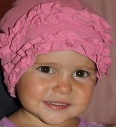making hats from old t-shirts.  Ruffled for girls, and I am thinking of using fun patches for boys, or bleach pen art.