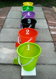How do you want to play it? Let the kids throw things into the buckets... (Spiders, bats, bones etc. get them at the dollar store)  then add up the numbers on the buckets that he actually got something in. The one with the highest numbers wins the game?