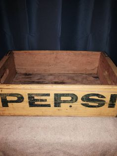 "Pepsi-Cola General Bottlers, Beverage bottle case  The crate has a broken corner and a little wood out of it, there is a crake down the back in the board in the middle. measures 18 1/3"" x 12"" x 5"" tall   please see pictures for more detail.    Please check with me on the shipping cost?  History:  Caleb Bradham of New Bern, North Carolina was a pharmacist at the turn of the century he had a soda fountain in his drugstore, refreshing drinks, that he created himself."