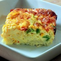 fiesta breakfast casserole 8 eggs 8 oz hashbrowns 1 cup peppers minced garlic 1 tsp cumin salt black pepper 1 cup cheddar cheese In a 8x8 glass buttered dish layer potatoes then the peppers. Whisk the eggs and seasoning. Pour over potatoes;sprinkle cheddar on top. Bake 375 degree oven for 40 - 45 minute
