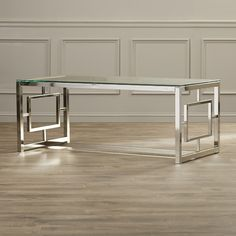 "Features:  -Steel frame.  -Glass table top.  Top Finish: -Clear.  Base Material: -Metal.  Base Finish: -Silver. Dimensions:  Overall Height - Top to Bottom: -19"".  Overall Width - Side to Side: -47.25"