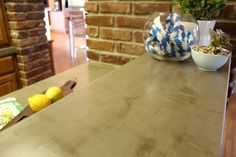 Concrete countertop look using a product called Ardex, from Kara Paslay blog