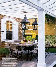 pergola, outdoor dining space and huge lanterns