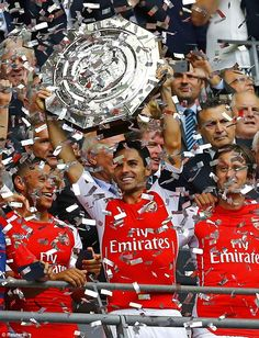 Good day out: Mikel Arteta lifts the Community Shield after a thumping win over the Premier League champions