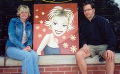 A client and myself with a large custom portrait painting.