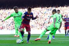 Neymar of FC Barcelona is brought down by Pedro Leon (L) of Getafe CF during the La Liga match between FC Barcelona and Getafe CF at Camp Nou on March 12, 2016 in Barcelona