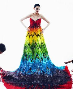 """The dress, modelled by American Jessica Pitti, was so heavy it required three adults to move it.    The multi-coloured jelly sweets were """"painstakingly glued on by hand"""" to the dress base, which comprised steel wire and vinyl sheets.    The pattern was inspired by Alexander McQueen's own design."""