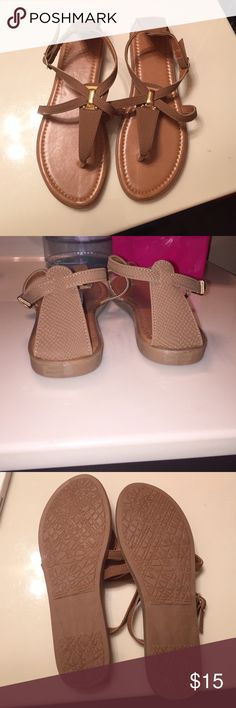 NWOT tan sandals Never worn. Brand new! Bought for my mom at a boutique in Houston and they were too small for her. Size 7/8 fits like a 7.5! Super cute! Comfy! Tan with gold accents Shoes Sandals